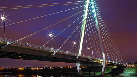 Northern Spire Bridge illuminated at night